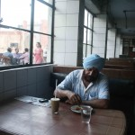 Photo Essay – The Aloofness of a Man in the Indian Coffee House