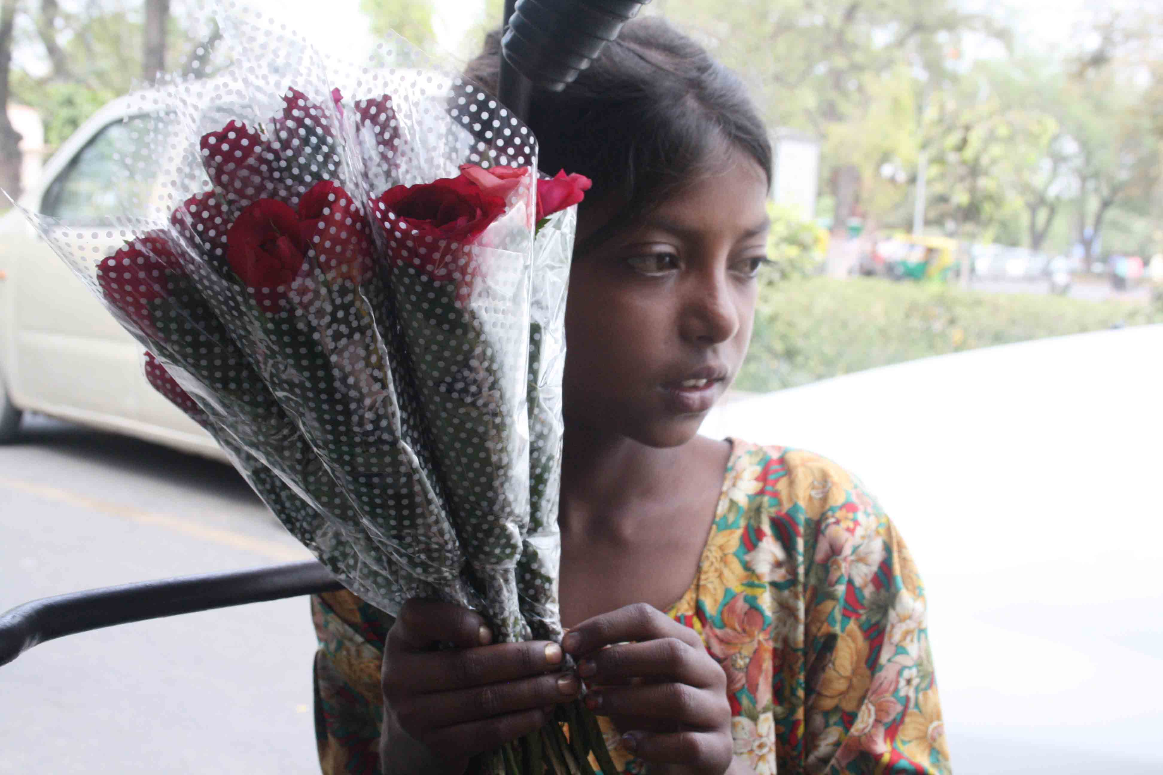 City Moment – The Girl With Red Roses, Near Sai Baba Temple