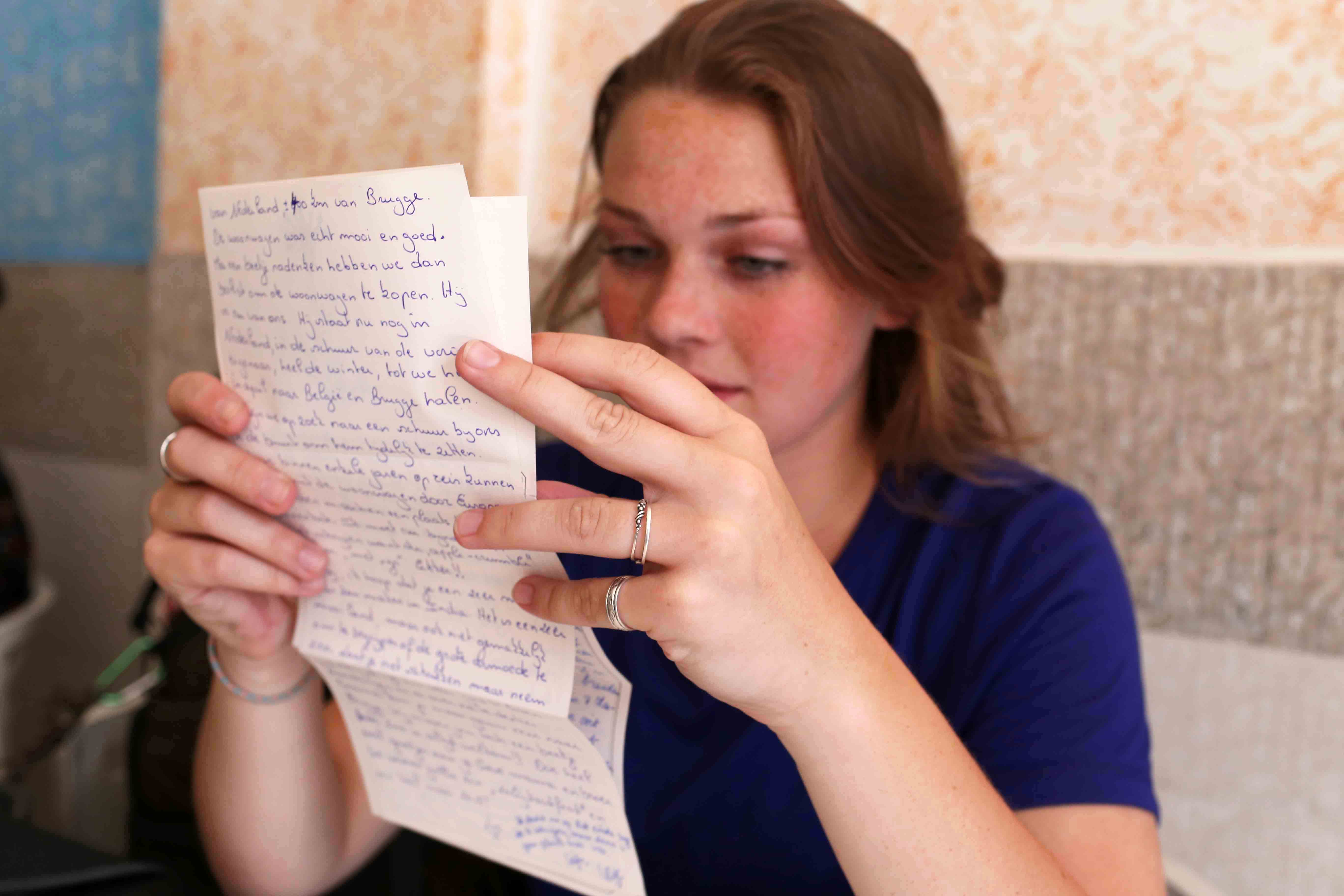 City Moment – Woman in Blue Reading a Letter,  Appetite German Bakery