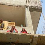 City Moment - Three Labourers Enjoying a Break, Sector 14, Gurgaon